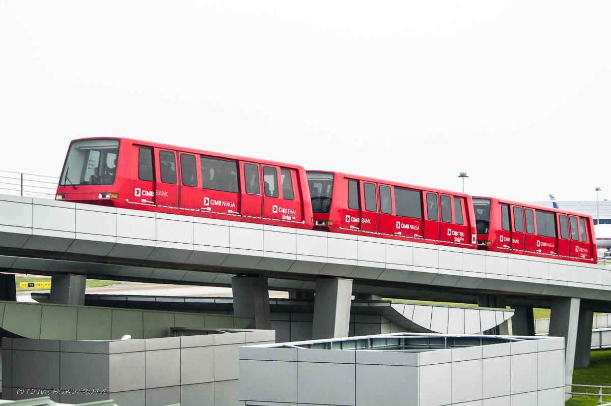 KLIA runs a driverless monorail train between the two main terminals. Between the terminals it drops down into a tunnel beneath a major taxiway.